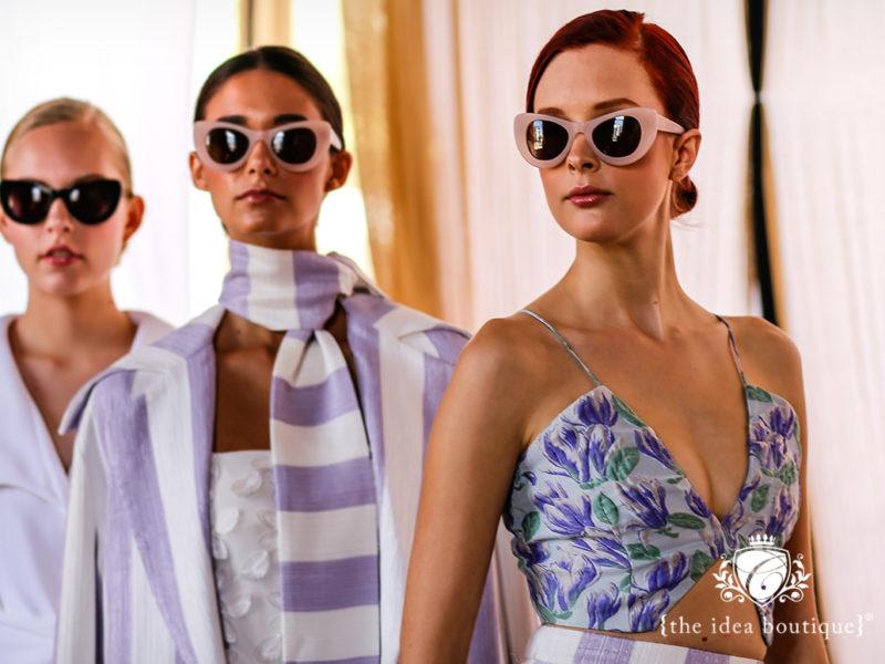 Models preparing to walk for the Christian Siriano trunk show Alys Beach