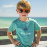young boy wearing the panama city beach party animal shirt