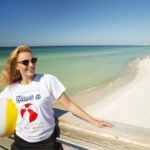 Woman sporting the Panama City Beach Have a Ball tshirt