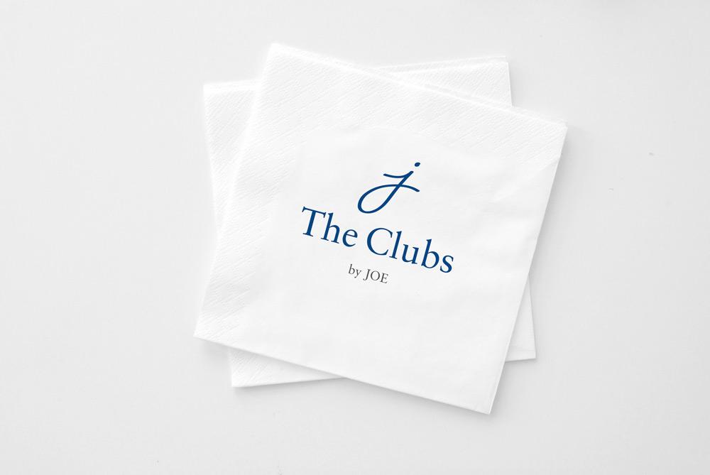 The Clubs by Joe logo on bar napkins