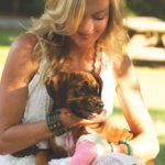 Laurie Hood Editorial Feature September/October 2014 Animal Issue - Laurie with puppy