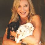Laurie Hood Editorial Feature September/October 2014 Animal Issue - Laurie with puppies