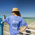 Woman wearing local flavor shirt Panama City Beach design