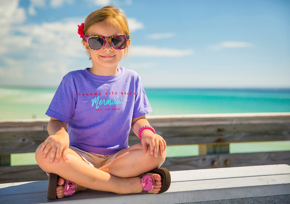 Little girl wearing mermaid tshirt for Panama City Beach brand
