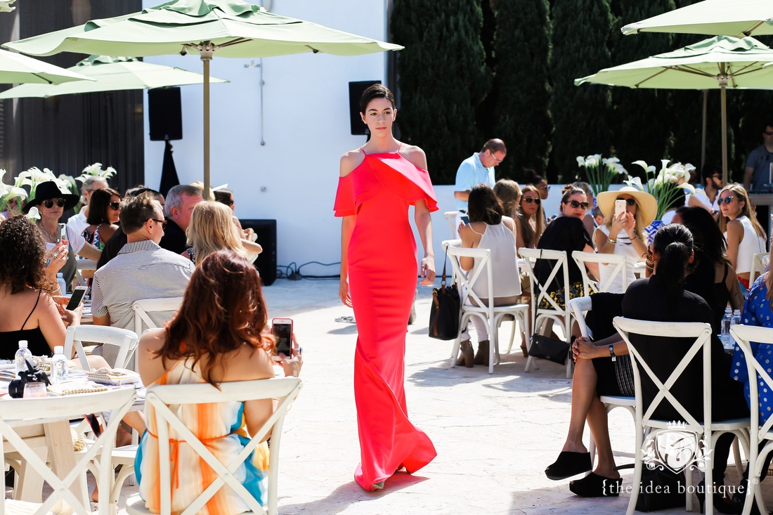 model walking in Christian Siriano at the trunk show in Alys Beach