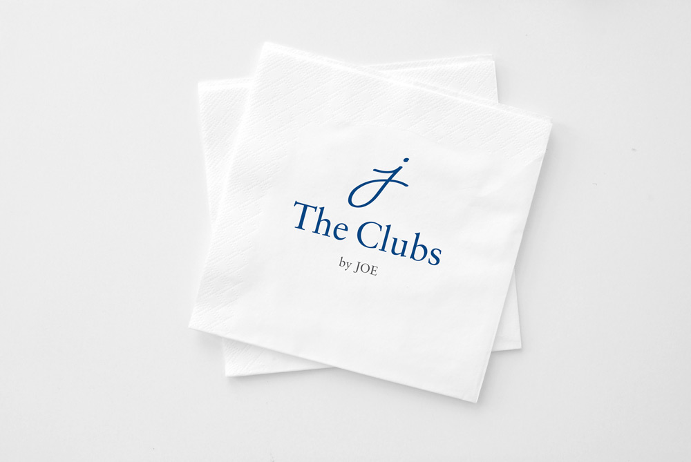 The Clubs by Joe logo on bar napkins